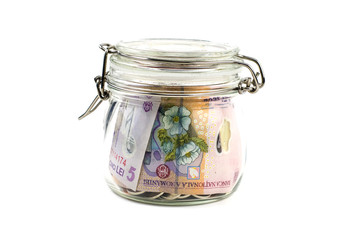 Banknotes in Glass Jar on White Background