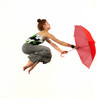 Girl jumping with red umbrella