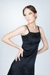 Young asian fashion woman posing in studio in black dress