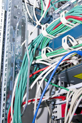 network cables and telecommunication equipment in the rack