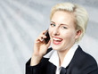 Nice business woman has fun with mobile phone