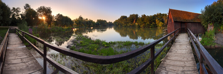 Watermill at sunrise - panoramic view