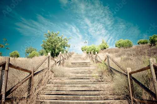 Wood stairs to beuatiful blue sky with clouds - 35896232