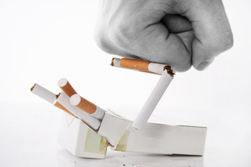 Man's hand breaking  cigarettes
