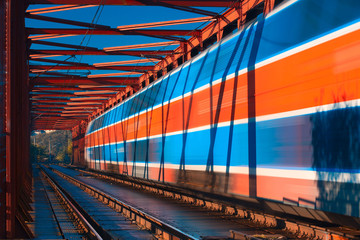Abstract composition of moving train on the old railway bridge
