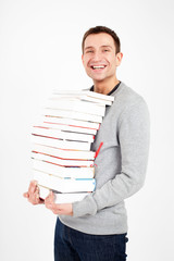 Happy student with a stack of books