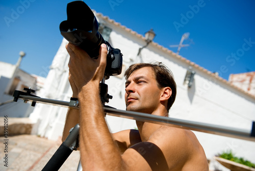 Handsome man with camcorder outdoors