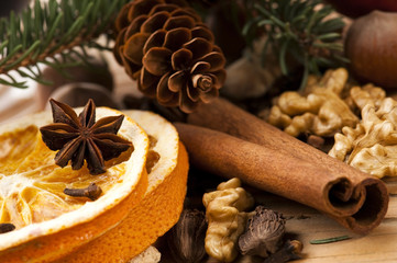 Different kinds of spices, nuts and dried oranges - christmas de