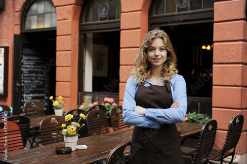 waitress in front of restaurant