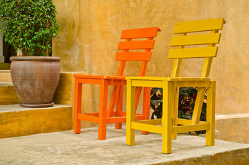 two color wood chair in garden