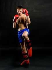 Portrait of young man with boxing  gloves