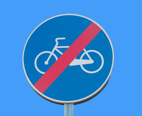 no cycles warning sign on blue sky