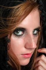 Depressed girl in black cloak