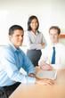 Latino Man Leading Business Meeting