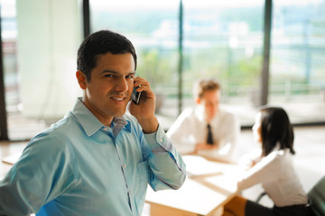 Latino Man Phone Call Business Meeting
