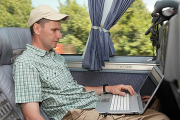 Man with laptop in the bus