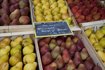 Selection of pears for sale on market stall