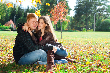Beautiful couple in autumn park