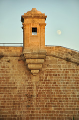 Turret of Acre fortification and the moon. Israel.