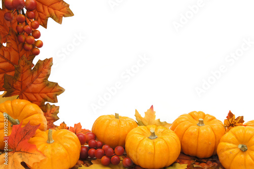 Border of autumn leaves and pumpkins