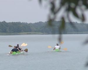 Many canoe sailing lake. A beautiful sunny day.