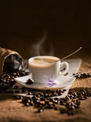 warm cup of coffee on brown background