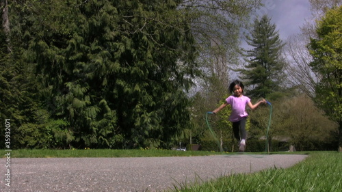Little Girl Running And Skipping Rope