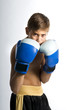 a child boxer in studio.