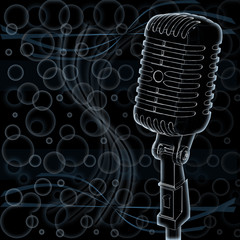 Microphone on abstract background of a dark
