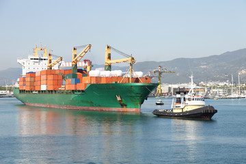 tug and container ship