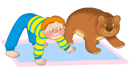 little boy and bear cub are on a mat