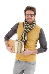Young man with books smiling