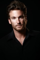 Portrait of handsome man in black