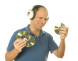 senior man listening to music cd discs with vintage head phones