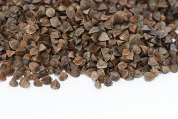 Dry raw buckwheat on white background
