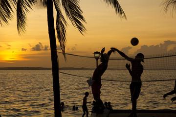 beach volleyball, sunset on the beach
