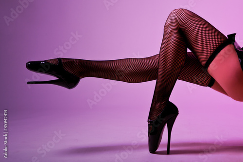 Sexy female legs in fishnet stockings and extreme fetish ballet