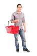 Portrait of a man holding an empty shopping basket
