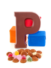 a Sinterklaas chocolate letter with gingernuts and gifts for a t