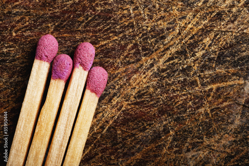 Matches on wooden table.