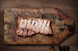 Pork ribs on wooden table.