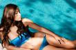bikini woman by the pool