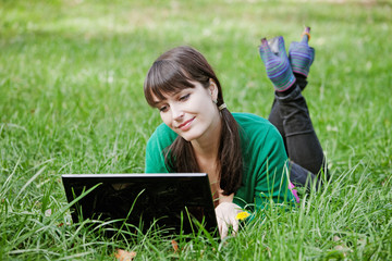 Active young sexy girl relaxing with laptop