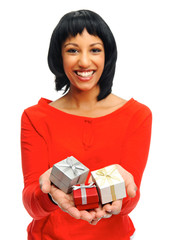 Pretty girl holding gift boxes