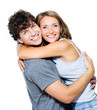 Smiling young couple embracing - isolated
