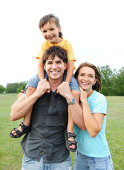 Happy young family with boy - outdoors