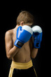 a child boxer in studio
