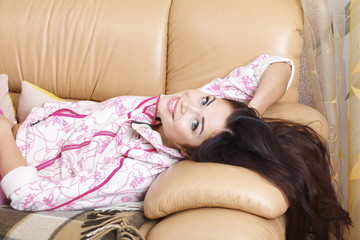 beautiful woman lying on the couch at home