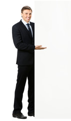 Full body of businessman showing signboard