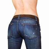 Sexy buttocks of beautiful girl in blue jeans with naked back poster